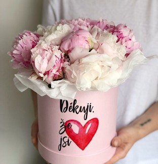 Peonies in a hat box with prints